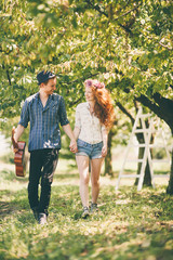 Couple Having a Walk in an Orchard