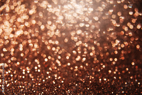 brown bright abstract bokeh background sparkle texture for birthday card new year christmas