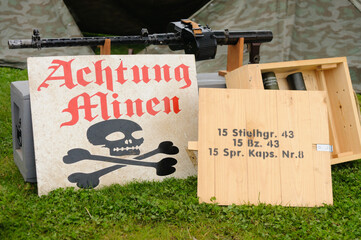 German warning sign for mines (minen) and a box of stick grenades.