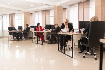 Businesswomen And Businessmen Looking At Computer