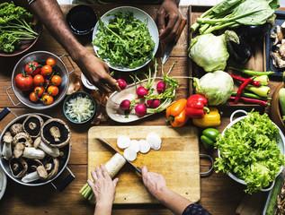 People prepare a fresh vegetable