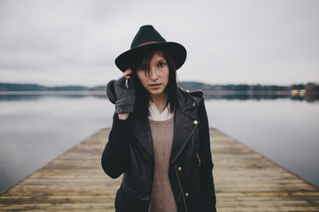 A portrait of a woman standing on a dock