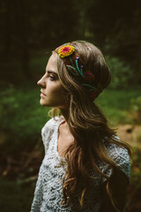 Girl standing in forest with headband on