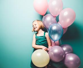 Girl Holding Ballons