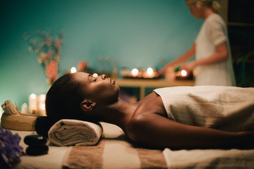 Woman relaxing on massage table at spa