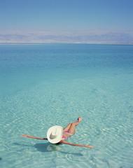 woman floating on the Dead Sea. Israel.