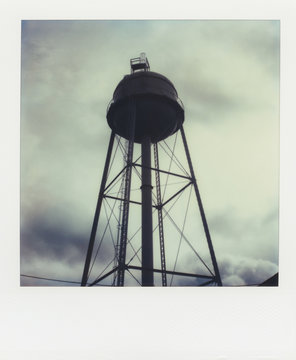 Water tower at dusk ( SX-70 print)