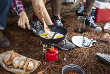 Campers making breakfast at the campsite