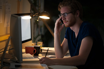 College Student Studying at Night