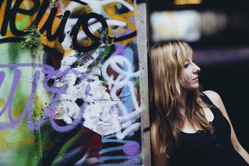 Girl at graffiti wall
