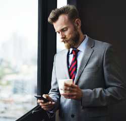 Businessman looking at his mobile phone
