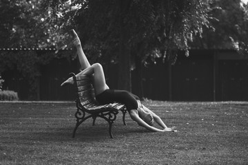 Young beautiful ballerina posing outdoors in a park