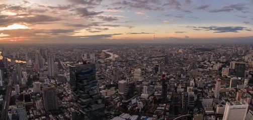 Bangkok City Skyline And Chao Phraya River At Dusk, High Aerial Panorama Shot