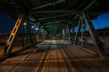 Colorful railway bridge by night