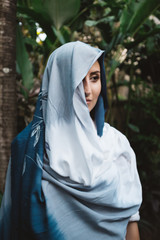 Woman Covered in a Blue Scarf