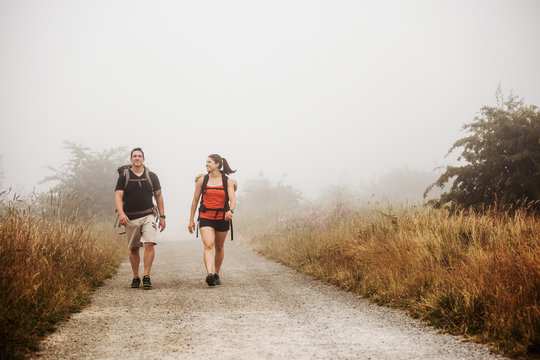 Hiking couple through the forest