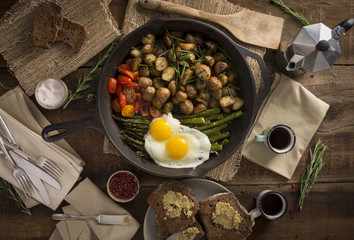 Breakfast:  Fried Eggs on Grilled Asparagus, Potatoes and Cherry Tomatoes