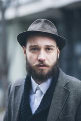 Young man looking at camera in urban environment