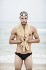 Portrait of swimmer by the sea