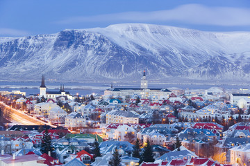 Iceland, Reykjavik, elevated view over the Churches and cityscape of Reykjavik with a backdrop of snow capped mountains