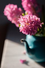 Three hyacinths in a tea pot