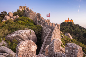 Moorish Castle and Pena Palace at sunset in Sintra, Portugal.