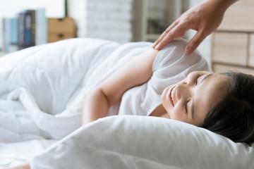 Asian girl is sleeping His girlfriend awakens her, smiles