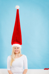 Happy woman having crazy windblown santa hat