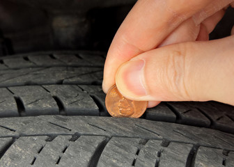 Checking tire tread depth and wear with a penny on Lincoln's head