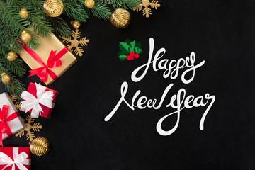 Happy New Year text on blackboard background