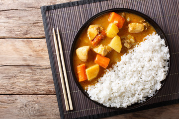 Japanese curry rice with meat, carrot and potato close-up on a plate. horizontal top view