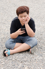 Technology in Daily Life.  asia boy wearing black T shirt