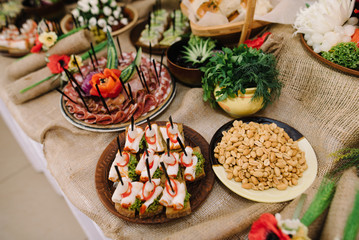 decorated catering banquet table with different food