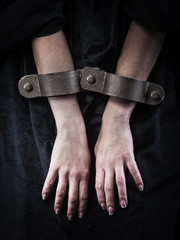 Hands in chains. Woman prisoner concept.