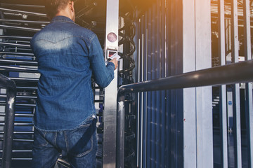 man in jeans use security card opening Electronic door lock