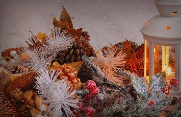 Burning lantern with christmas decorations