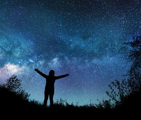 Girl watching the stars in night sky