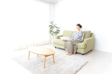 Woman pointing to something at home