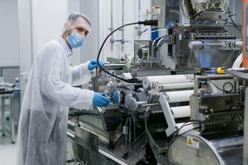 scientist work with manufacture machine