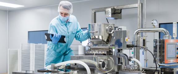 scientist making notes about machine