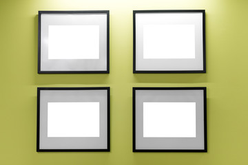 Mock up. Blank picture frames on yellow wall. Gallery wall with empty frames indoor.
