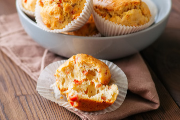 Homemade muffins with bacon and cheese in a gray plate. Healthy snack or breakfast meal. Wooden background.