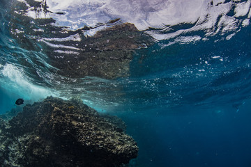 Underwater shot of Sail rock with water surface on aquatic background