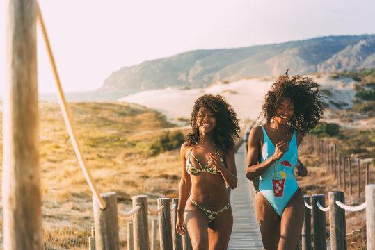 Cheerful women running on pier