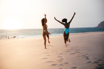 Women running in love on beach