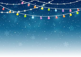 Christmas light bulbs on starry background