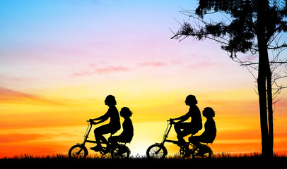 silhouette  young girl riding bicycle