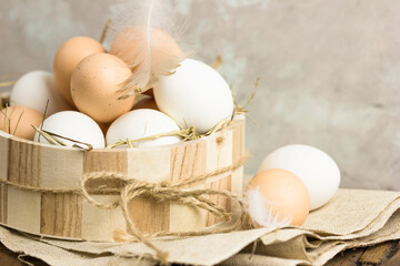 Close up of eggs in a basket. top view of eggs in bowl. Brown eggs in wooden bowl. Chicken Egg. Hen eggs basket