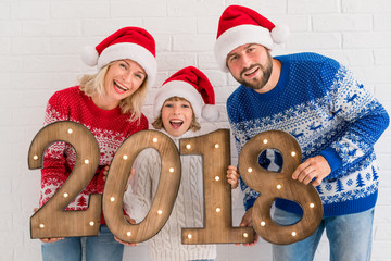 Happy family holding numbers 2018
