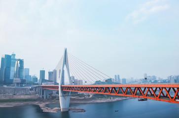 modern bridge above river in city